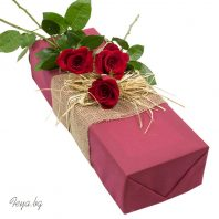 Three red roses in box